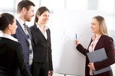 Colleagues discuss project — Stock Photo