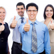 Business people showing thumbs up sign — Stock Photo