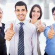 Business people showing thumbs up sign — Stock Photo #44792795