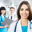 Female doctor standing in front of her team — Stock Photo #44797527