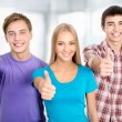 Students show thumbs up — Stock Photo