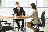 Businesspeople working at meeting — Stockfoto