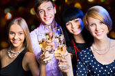 Happy people at party — Stock Photo