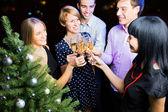 Friends celebrating Christmas — Stock Photo