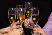 Hands with glasses full of champagne — Foto de Stock