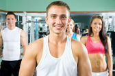 Fitness instructor with gym people — Stock Photo