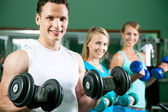 Man with weight training equipment — Stock Photo
