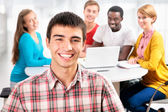 Pretty  student and his friends — Stock Photo