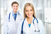 Female doctor with colleague — Stock Photo