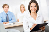Business woman with team — Stock Photo