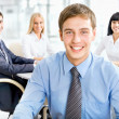 Happy business man with colleagues — Stock Photo #44800237