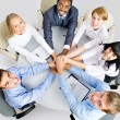 Business team making pile of hands — Stock Photo #44802067
