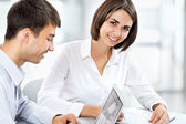 Business woman with colleague — Stock Photo