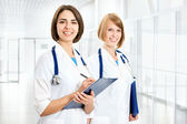 Portrait of two successful female doctors — Stock Photo