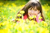 Beautiful girl enjoying sun on meadow — Stock Photo