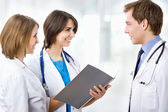 Doctor with colleagues — Stock Photo