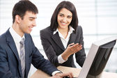 Business people with computer — Stock Photo