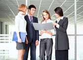 Business people discussing in a office corridor — Stock Photo