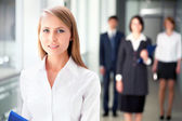 Businesswoman with colleagues — Stock Photo
