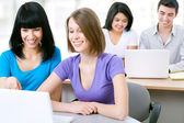 Students with laptops — Stock Photo