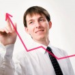 Businessman pointing on graph — Stock Photo #44868237