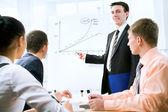 Businessman presenting ideas on whiteboard — Stock Photo