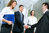 Business people greet each other — Stock Photo