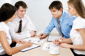 Four business people — Stock Photo