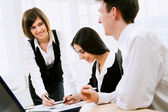 Business man with colleagues — Stock Photo