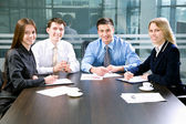 Businesspeople look at camera — Stock Photo