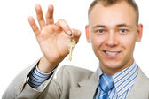 Businessman with a key — Stock Photo