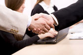 Business people shaking hands — Stok fotoğraf