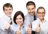 Business people giving the thumbs-up — Stock Photo