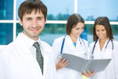 Doctor with two nurses — Stock Photo
