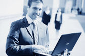 Businessman with laptop — Stock Photo