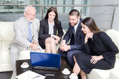 Business people with laptop — Stock Photo