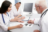 Doctor with two of her co-workers — Stock Photo