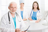 Doctor with two co-workers — Stock Photo