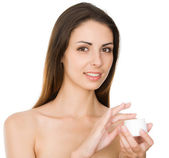 Woman applying cream — Stock Photo