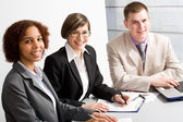 Businesspeople looking at camera — Foto Stock