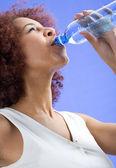 Girl drinking water — Stock Photo