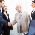 Handshake and teamwork — Stock Photo #45071005