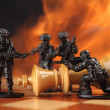 Toy soldiers kill chess King in fire. — Stock Photo #44375921