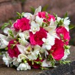 Bouquet of fresh flowers of white and red colors of orchids and roses for a wedding ceremony. — Stock Photo #45582947