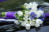 Bouquet of fresh flowers blue and white colors of irises and tulips for the wedding ceremony. — Stock Photo