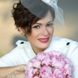 Portrait of an extravagant bride with a bouquet of flowers. — Stock Photo #46174161