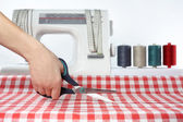 Tailor. Sewing. Cutting fabric. Dressmaker at work. Fabric cutting scissors. — ストック写真