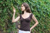 Beautiful Girl Enjoying Nature. Young Woman Contemplate Plant. — Stock Photo