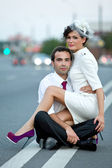 Wedding. Bride and groom on the road at dusk. — Stock Photo