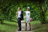 Wedding. Bride and groom in the garden on a summer evening. — Foto Stock